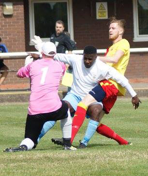 Studley's goalkeeper and a defender thwart a Lichfield City attack. Pic: Mick Tyler