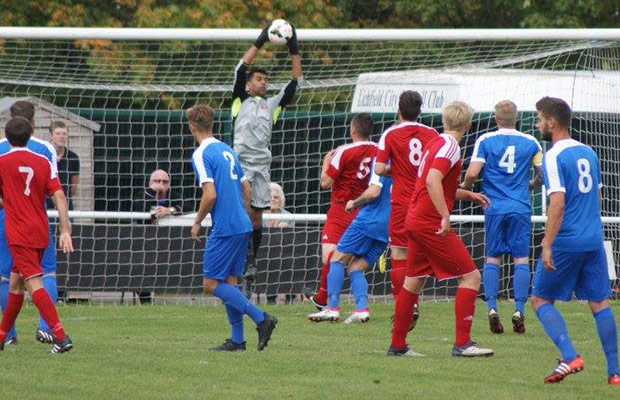Lichfield City keeper Amrick Virdee collects a high cross to deny Pershore. Pic: Mick Tyler