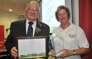 Hilary Smith accepts the environmental award from Les Goodman, president of Heart of England in Bloom
