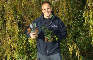 Community gardener Paul Niven collecting items for Christmas wreaths