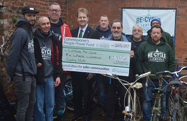 Police and Crime Commissioner Matthew Ellis hands over a cheque to Lichfield Re:Cycle