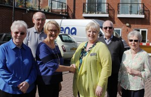 Bromford's Helen Shields shakes hands with Radis Community Care area manager Joan Trevis outside Beacon Park Village, alongside residents Lilian and Brian Ashwell and David and Joan Lambert