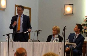 Paul Ray (standing) speaking at the hustings event alongside Michael Fabricant and Robert Pass