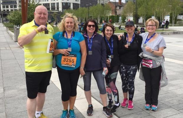 Logan Khan, Angela Hiney Bancroft, Sue Kinsey, Luisa Cockerill, Jennine Phillips and Anne-Marie Taylor show off their Birmingham 10k medals