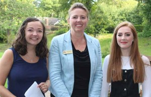 Students Lucy Windsor and Anisha Jordan with Lichfield Cathedral School headteacher Susan Hannam
