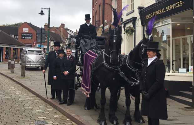 The Jukes Funeral Services team with horse-drawn hearse outside The House of Minster Funeral Home