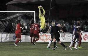 The Market Drayton Town keeper claims a cross. Pic: Pamela Mullins