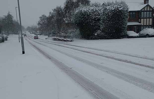 Snow covered roads on Boley Park in Lichfield