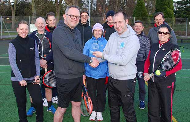 Phil Shaw receiving his award from Phil Jessop with tennis players at Beacon Park