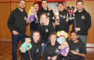 The cast of Avenue Q with some of the puppets