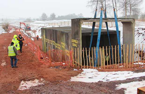 The last piece of the current tunnel being moved into place
