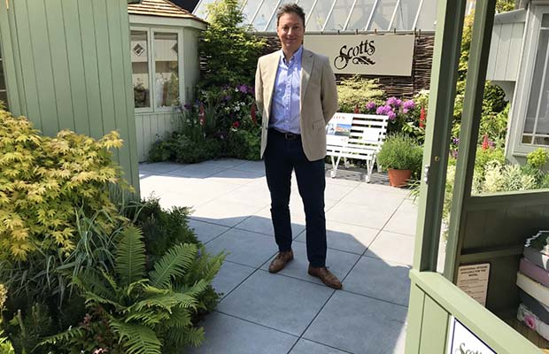 Ethan Mason managing director Mike Leeming with his porcelain company's paving on show at the Chelsea Flower Show