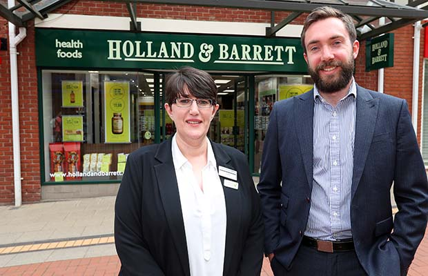 Store manager Sarah Deavey with area manager Ed Westlake outside the new store