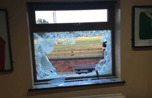 A smashed window at Burntwood Rugby Club