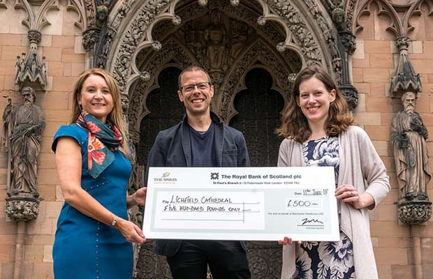Lichfield Cathedral's artist-in-residence Peter Walker receiving the donation