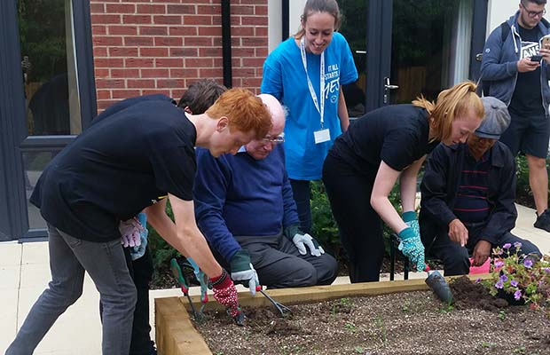The new flower beds being created