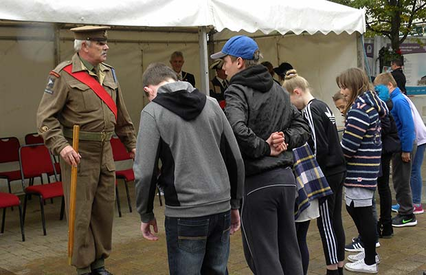 A sergeant major putting young 'recruits' through their paces