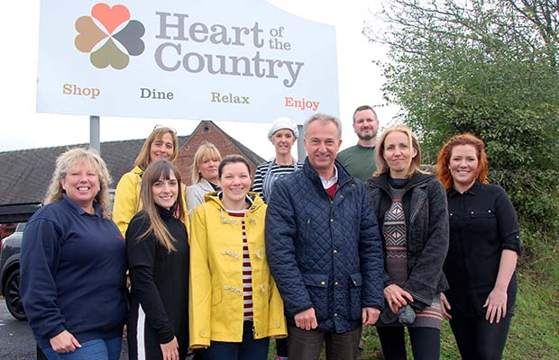 Julian Fisher with representatives from the Heart of the Country Shopping Village