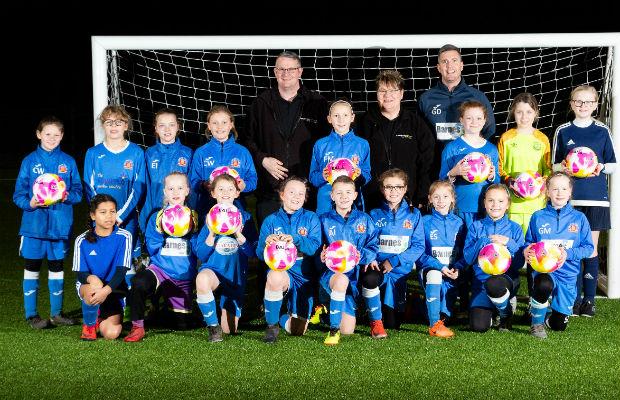 Lichfield Wildcats with their new Fairtrade Fortnight footballs