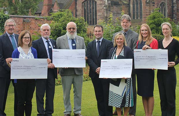 Cllr Iain Eadie (centre) with representatives from the successful organisations