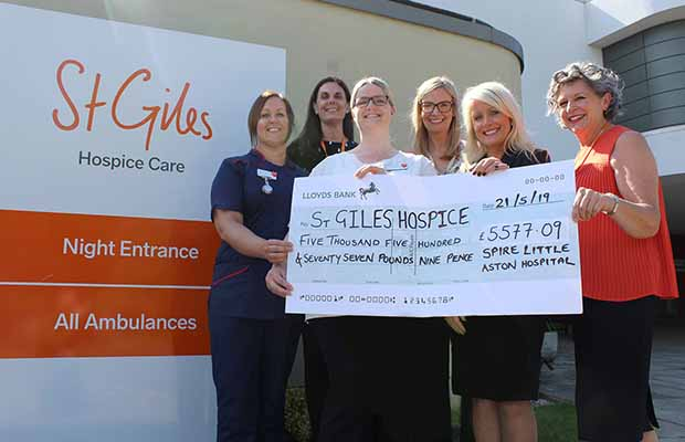 The cheque is handed over to St Giles Hospice