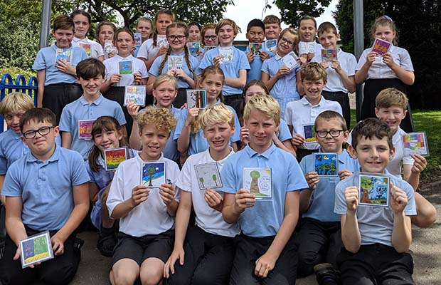 Scotch Orchard pupils with copies of their CD