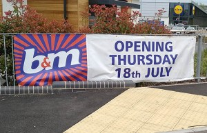 A sign showing the opening date for the new B&M store in Lichfield