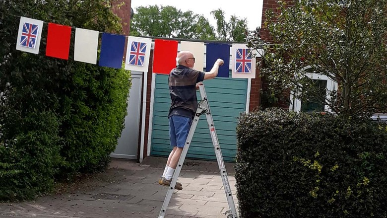 Ann and Terry Hancox getting their bunting ready in Burntwood