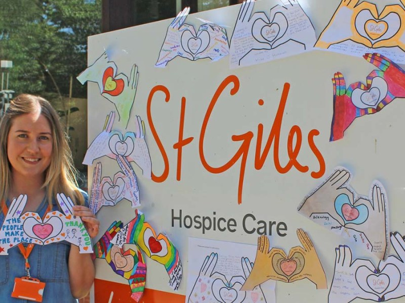 Amy Moore at St Giles with some of the #HandsTogether decorations made by volunteers