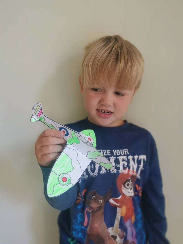 Picture of Finn with his homemade Spitfire