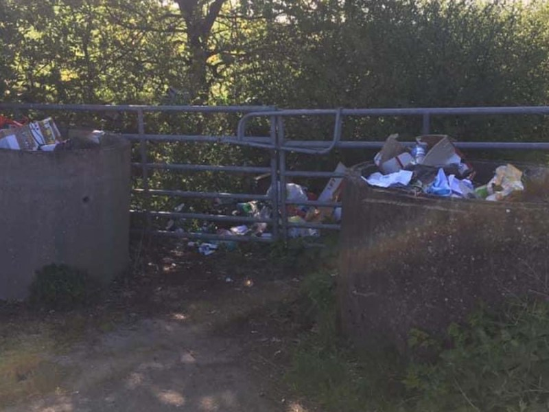 The rubbish dumped at the entrance to a field in Hammerwich