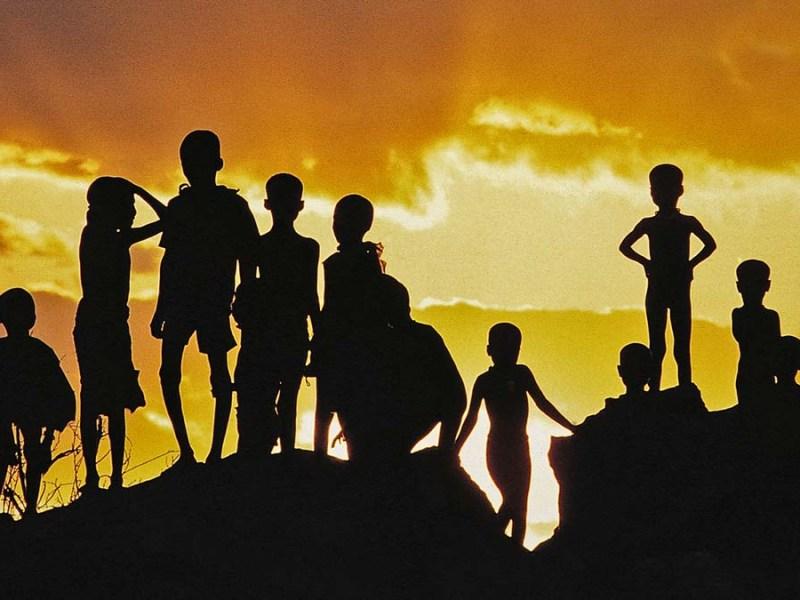 African children at sunset - David Keith Jones