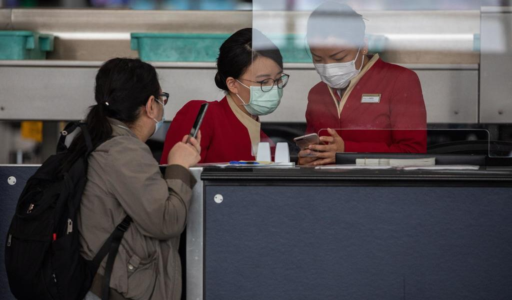 China detecta 18 nuevos casos importados de COVID-19