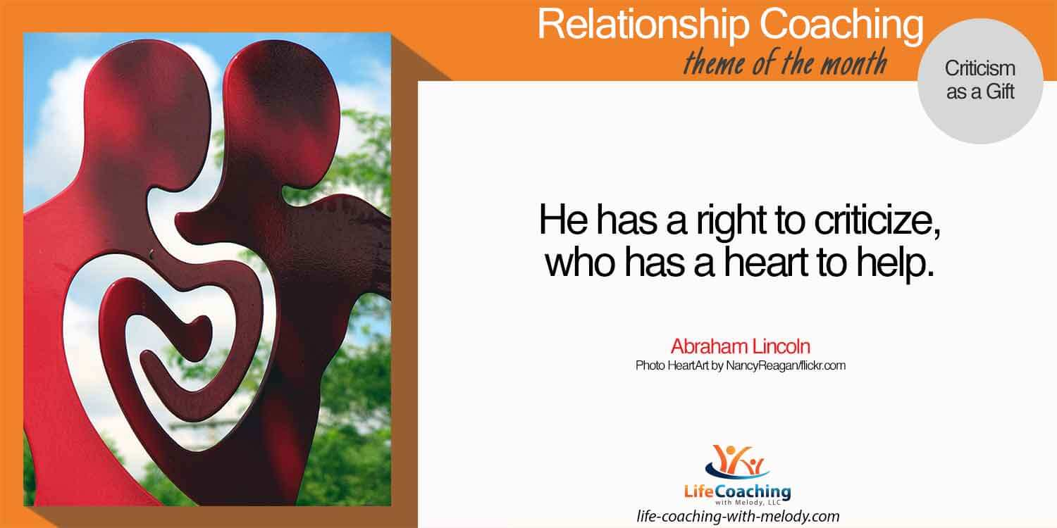 Image of red sculpture of 2 persons with emphasis on their hearts as one. Criticism, can you receive it as a gift?