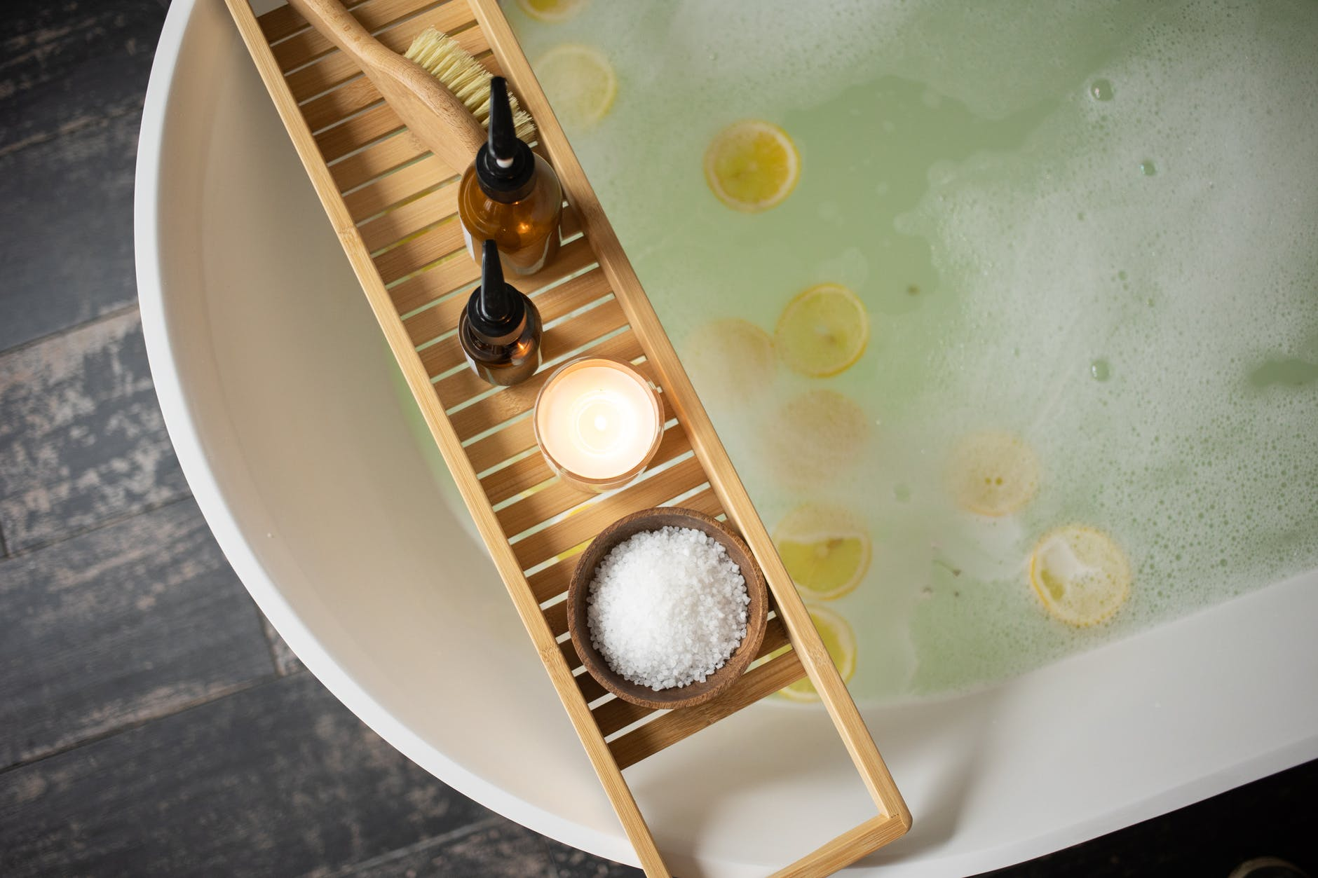 set of products for skincare on bathtub