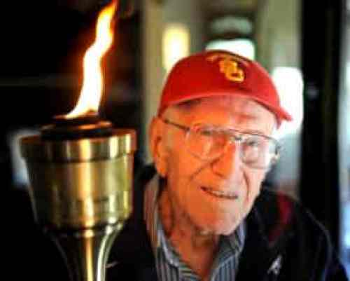 Louis Zamperini with Olympic torch