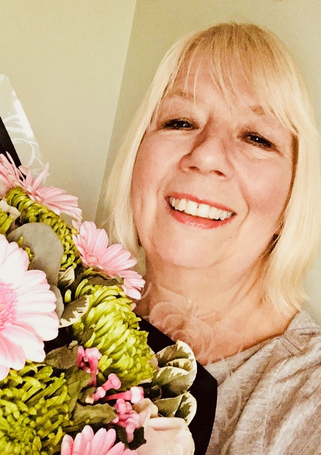 Pat Blake with a bouquet of Prestige Flowers
