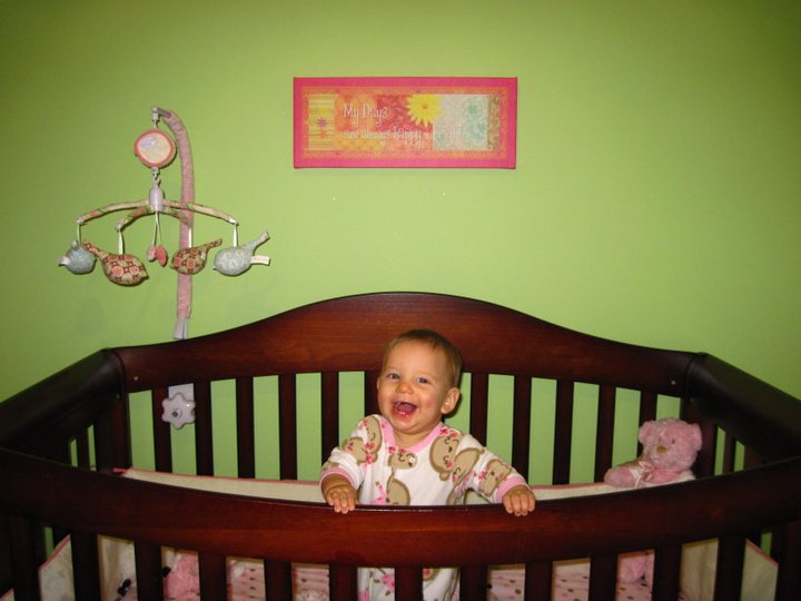 The first time she stood in her crib, which means that mobile and the bumper came down that day! First Christmas Eve.