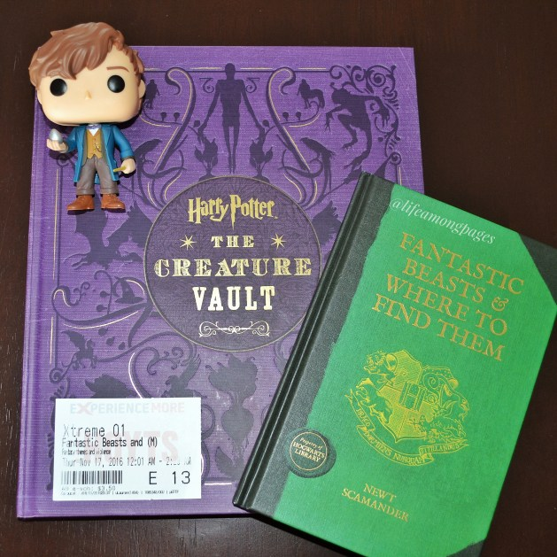 Fantastic beasts and where to find them movie ticket, with the text book, my copy of The Creature Vault and a Newt Scamander pop figurine.