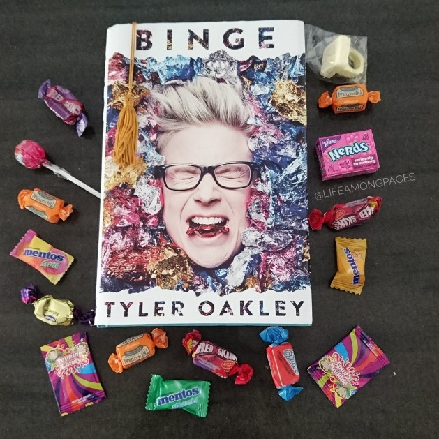 Binge by Tyler Oakley hardcover surrounded by candy