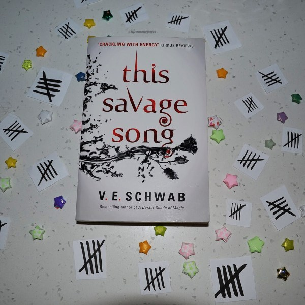 Cover for This Savage Song by V.E. Schwab surrounded by paper stars and tally marks