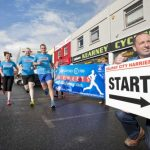 Frank Kearney guides Emer Whyte, Catherine Keane Murphy, Donal Gill and Hugh O' Donoghue from Galway City Harriers in the right direction at the launch of the 2014 Kearney Cycles Streets of Galway 8K Road Race which takes place on August 9. Photo: Declan Monaghan/Galway Focus