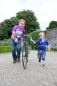 Cycling legend, Sean Kelly, pictured with Aaron Duignan, 6, from Meath launching Down Syndrome Ireland's inaugural Tour de Leinster charity cycle at the Royal Hospital Kilmainham. The four day event will take place from 18th – 21st September 2014 in aid of Down Syndrome Ireland. For further information log onto www.tourdeleinster.ie or follow it on twitter @ tourdeleinster. Photo; Mac Innes Photography