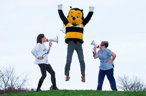 Buzz to it! Hayley Muir (left) and Claire Watson from Highland Hospice give CEO Kenny Steele some gentle encouragement during a training run. He is aiming to beat the world record for the fastest time recorded by a mascot at the Inverness Half Marathon.