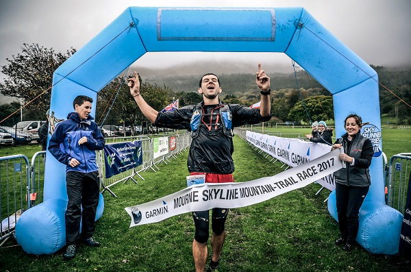 Ian Bailey, Newcastle AC crosses the finish line at this year's Garmin Mourne Skyline MTR 2017 Race in Donard Park, Newcastle
