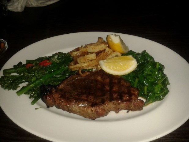 Well done steak, steamed broccoli, spinach & onion rings.