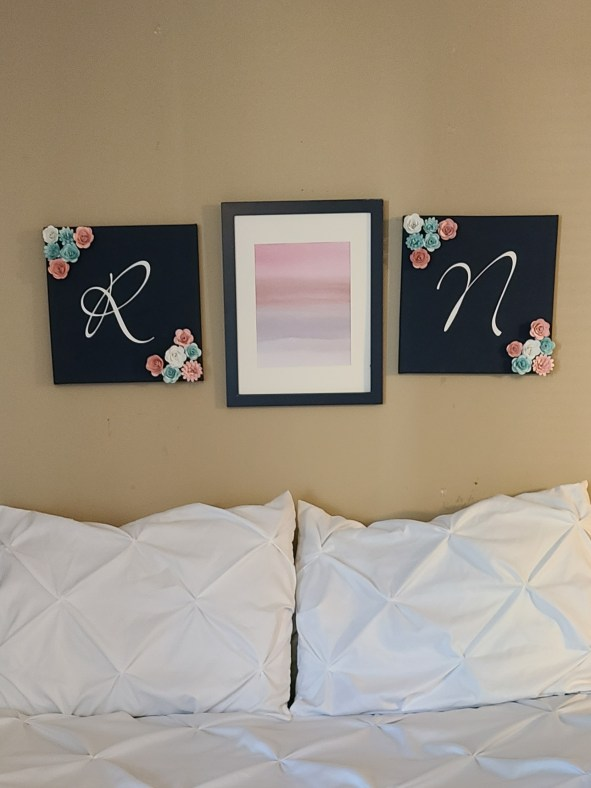 Canvas wall art in place of a headboard.