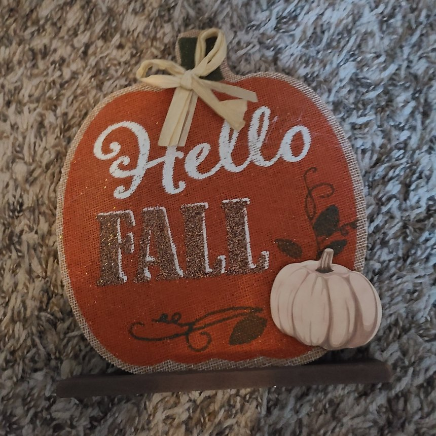 """Table top sign that says """"Hello Fall."""" This will become the DIY fall Dollar Tree frame."""