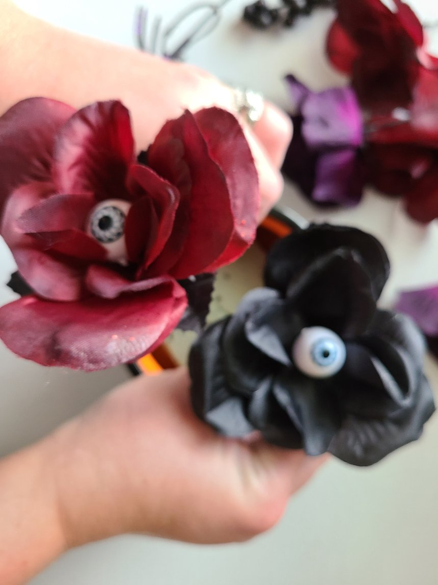 Adding black & burgundy roses with eyeballs in the center to the quick and easy Halloween centerpiece.