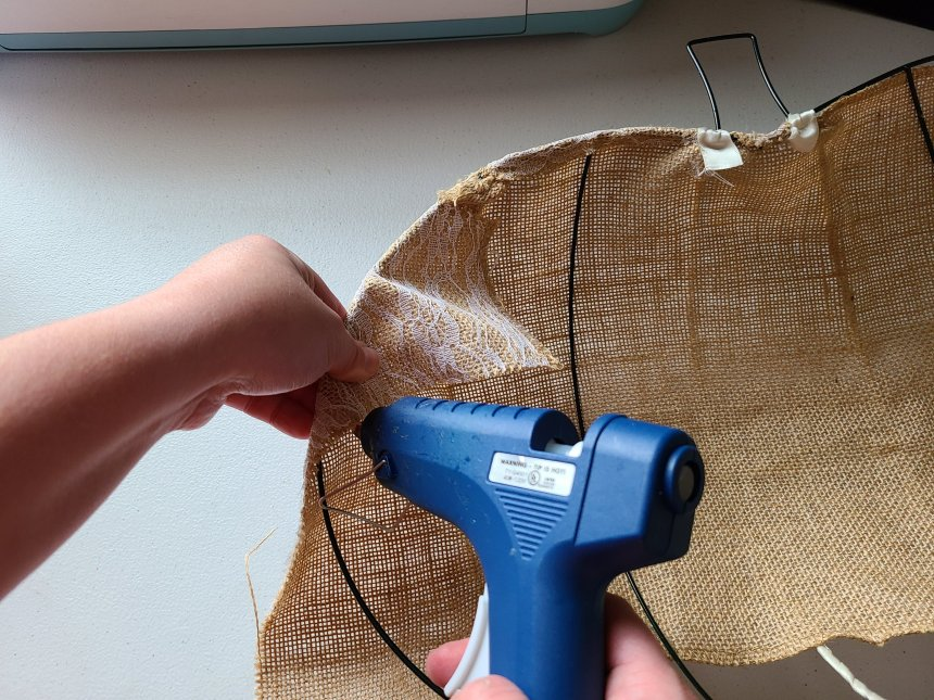 Complete the gluing of the fabric around the outer top and edge of the form.